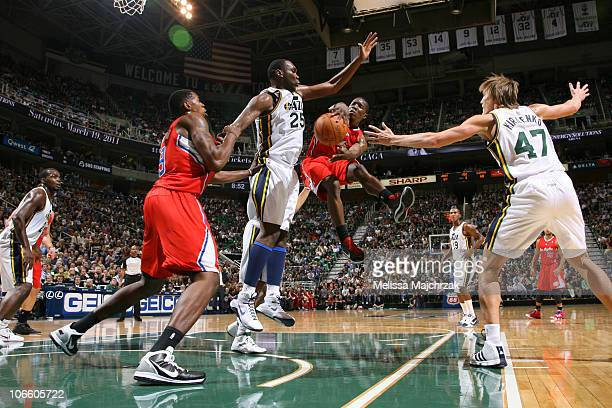 Eric Bledsoe of the Los Angeles Clippers passes around Al Jefferson of the Utah Jazz at EnergySolutions Arena on November 6 2010 in Salt Lake City...