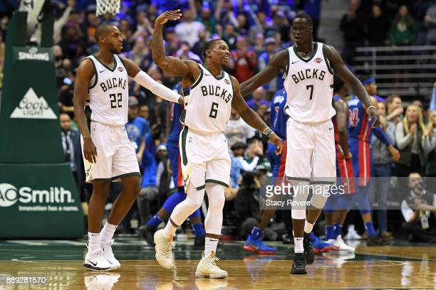 Eric Bledsoe of the Milwaukee Bucks celebrates with Khris Middleton and Thon Maker during the second half of a game against the Detroit Pistons at...