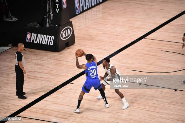 Eric Bledsoe of the Milwaukee Bucks defends against Markelle Fultz of the Orlando Magic for Game five of the first round of the 2020 Playoffs as part...