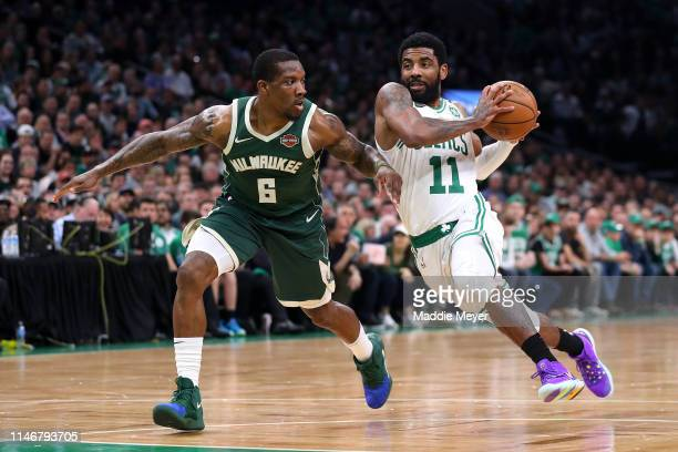 Eric Bledsoe of the Milwaukee Bucks defends Kyrie Irving of the Boston Celtics during the first quarter of Game 3 of the Eastern Conference...