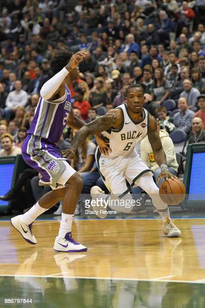 Eric Bledsoe of the Milwaukee Bucks drives around Buddy Hield of the Sacramento Kings during a game at the Bradley Center on December 2 2017 in...