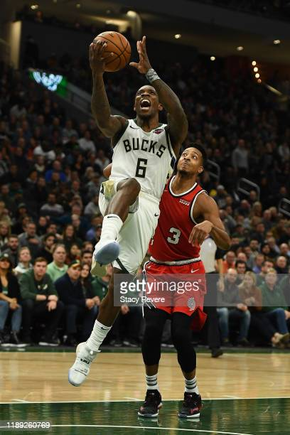 Eric Bledsoe of the Milwaukee Bucks drives to the basket against CJ McCollum of the Portland Trail Blazers during the second half of a game at Fiserv...