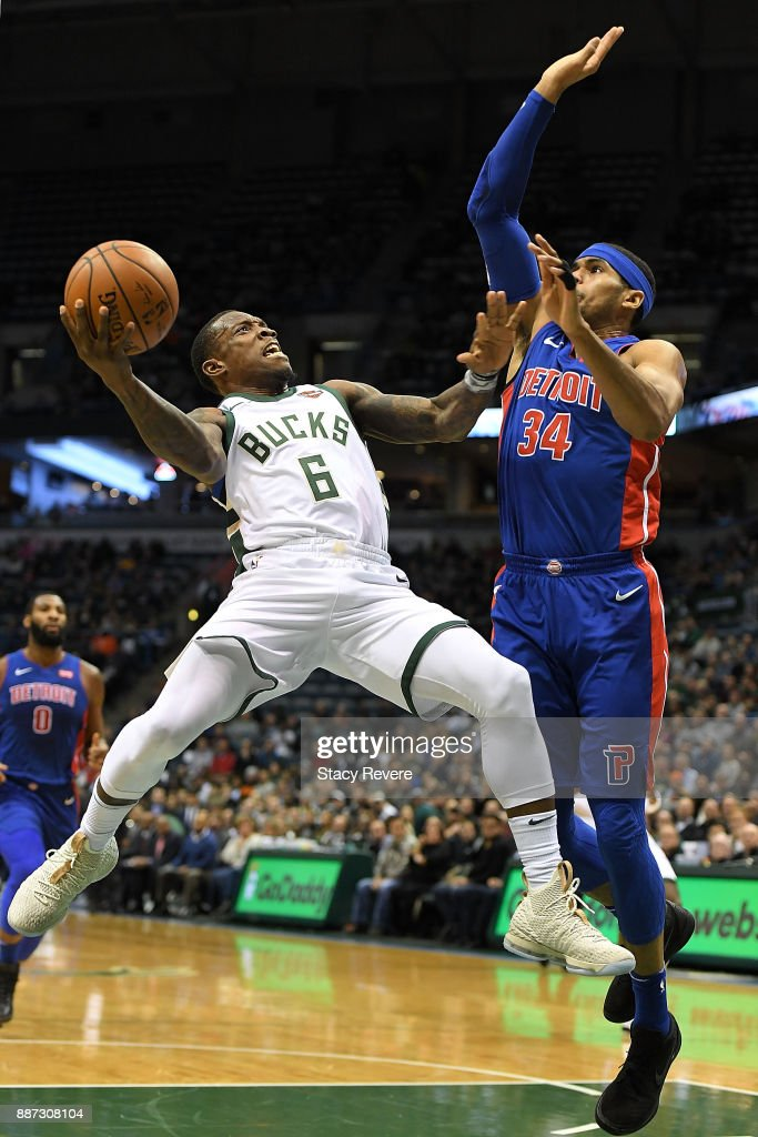 Eric Bledsoe #6 of the Milwaukee Bucks drives to the basket against Tobias Harris #34 of the Detroit Pistons during the first half of a game at the Bradley Center on December 6, 2017 in Milwaukee, Wisconsin.