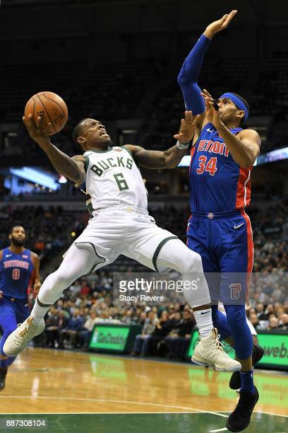 Eric Bledsoe of the Milwaukee Bucks drives to the basket against Tobias Harris of the Detroit Pistons during the first half of a game at the Bradley...