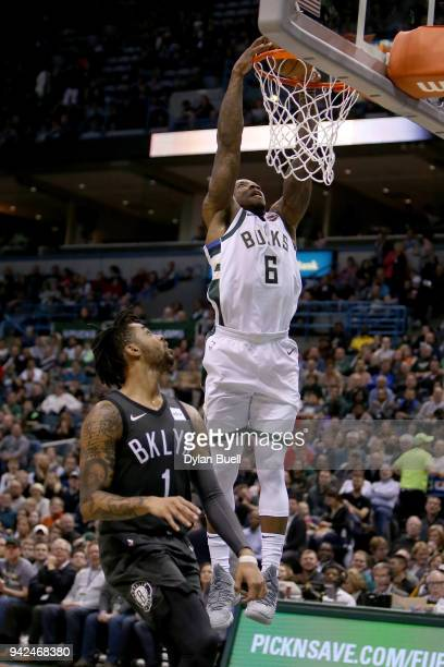 Eric Bledsoe of the Milwaukee Bucks dunks the ball past D'Angelo Russell of the Brooklyn Nets in the third quarter at the Bradley Center on April 5...