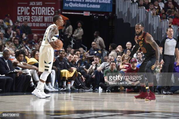 Eric Bledsoe of the Milwaukee Bucks handles the ball against LeBron James of the Cleveland Cavaliers on March 19 2018 at Quicken Loans Arena in...