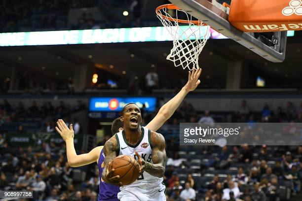 Eric Bledsoe of the Milwaukee Bucks is fouled by Dragan Bender of the Phoenix Suns during the second half of a game at the Bradley Center on January...