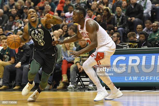 Eric Bledsoe of the Milwaukee Bucks is fouled by Jerian Grant of the Chicago Bulls during a game at the Bradley Center on December 15 2017 in...