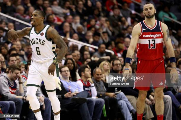 Eric Bledsoe of the Milwaukee Bucks reacts in front of Marcin Gortat of the Washington Wizards after shooting a threepointer during the second half...