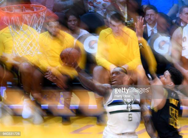 Eric Bledsoe of the Milwaukee Bucks scores on a layup past Josh Hart of the Los Angeles Lakers in overtime leading the Bucks to a 124122 win at...
