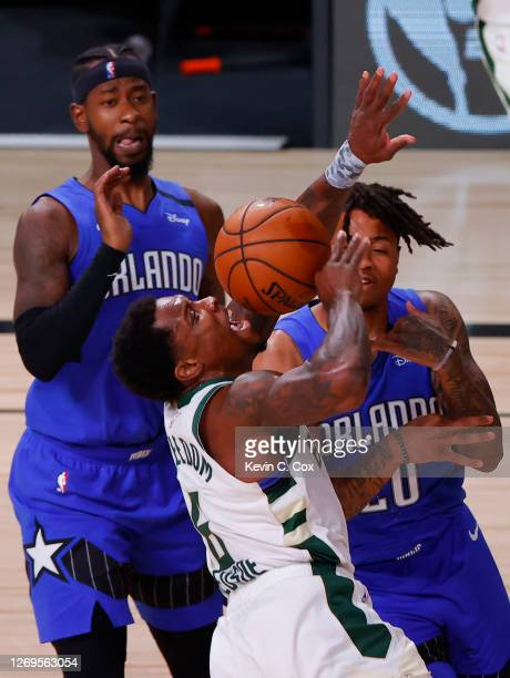 Eric Bledsoe of the Milwaukee Bucks tangles with Markelle Fultz of the Orlando Magic during the second quarter in Game Five of the Eastern Conference...