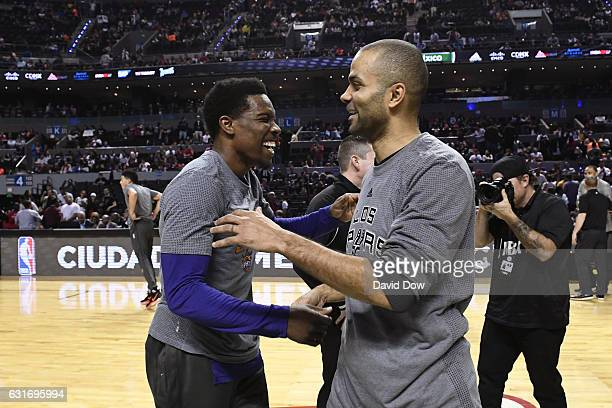 Eric Bledsoe of the Phoenix Suns and Tony Parker of the San Antonio Spurs shake hands before the game as part of NBA Global Games at Arena Ciudad de...