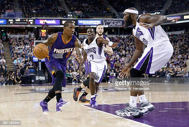 Eric Bledsoe of the Phoenix Suns drives on Reggie Evans of the Sacramento Kings at Sleep Train Arena on December 26 2014 in Sacramento California