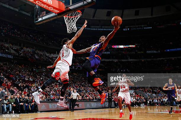Eric Bledsoe of the Phoenix Suns goes for the dunk against Derrick Rose of the Chicago Bulls during the game on December 7 2015 at United Center in...