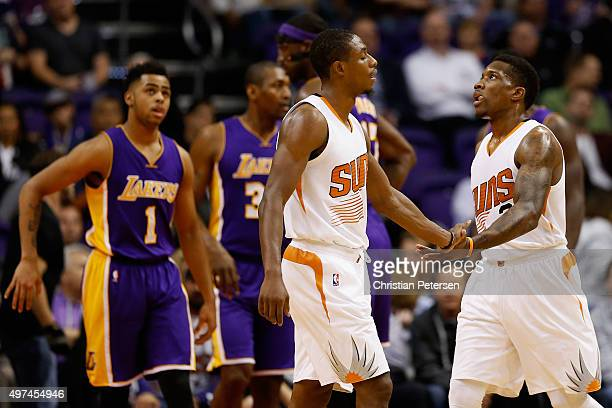 Eric Bledsoe of the Phoenix Suns highfives Brandon Knight after scoring against the Los Angeles Lakers during the first half of the NBA game at...