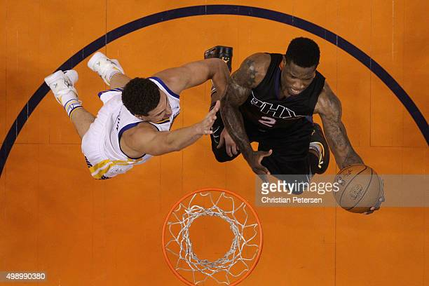 Eric Bledsoe of the Phoenix Suns lays up a shot past Klay Thompson of the Golden State Warriors during the first half of the NBA game at Talking...