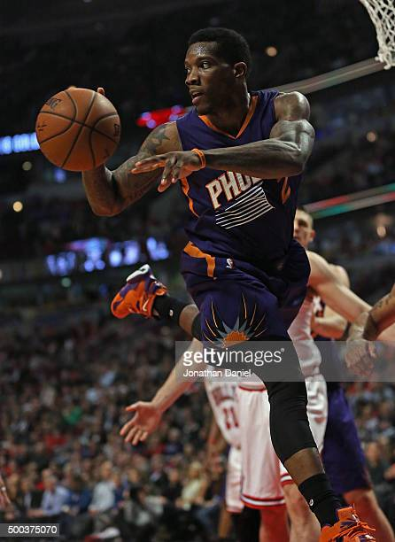 Eric Bledsoe of the Phoenix Suns passes after grabbing a rebound against the Chicago Bulls at the United Center on December 7 2015 in Chicago...