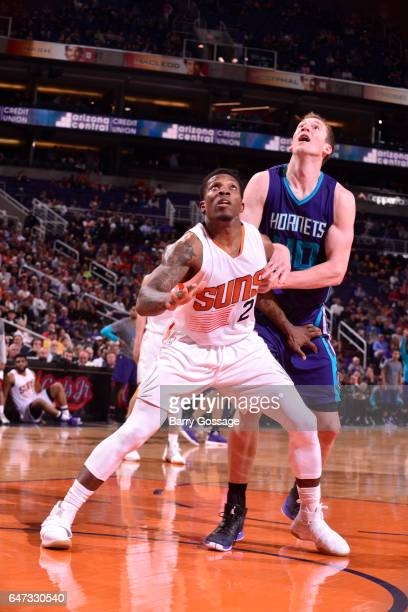 Eric Bledsoe of the Phoenix Suns plays defense against Cody Zeller of the Charlotte Hornets during the game on March 2 2017 at Talking Stick Resort...