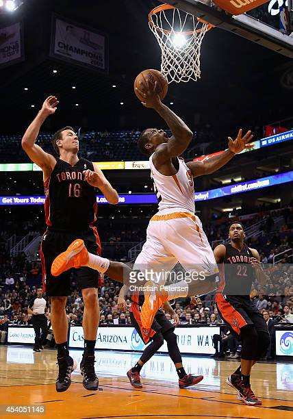 Eric Bledsoe of the Phoenix Suns puts up a shot past Steve Novak of the Toronto Raptors during the second half of the NBA game at US Airways Center...