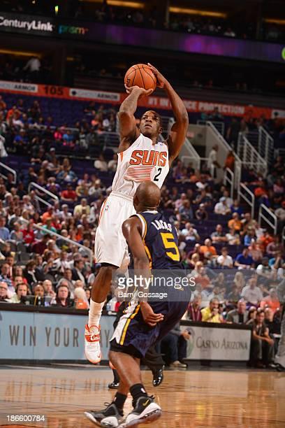 Eric Bledsoe of the Phoenix Suns shoots against John Lucas III of the Utah Jazz on November 1, 2013 at U.S. Airways Center in Phoenix, Arizona. NOTE...