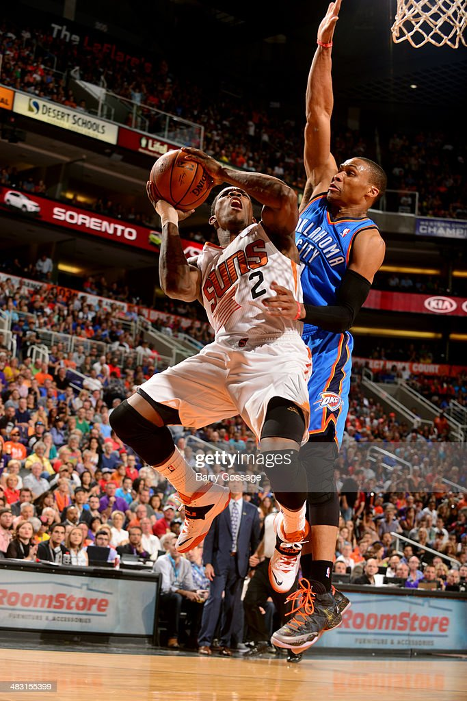 Eric Bledsoe #2 of the Phoenix Suns shoots against Russell Westbrook #0 of the Oklahoma City Thunder on April 6, 2014 at U.S. Airways Center in Phoenix, Arizona.