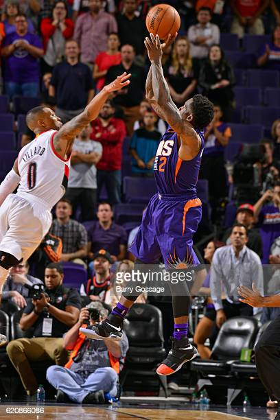 Eric Bledsoe of the Phoenix Suns shoots the game winning three point basket in overtime over Damian Lillard of the Portland Trail Blazers on November...