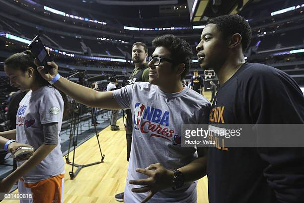 Eric Bledsoe pose for a selfie photo with a fan during the Phoenix Suns training session at Arena Ciudad de Mexico on January 11, 2017 in Mexico...