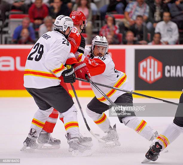 Eric Blum and Philippe Furrer of SC Bern during the Champions Hockey League group stage game between HC Ocelari Trinec and SC Bern on August 21...