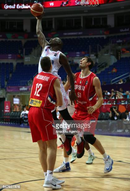 Eric Boateng of Great Britain in action against Boban Marjanovic and Dragan Milosavljevic of Serbia during the FIBA Eurobasket 2017 Group D Men's...