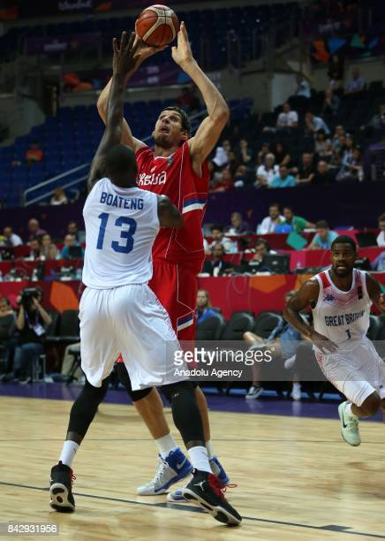 Eric Boateng of Great Britain in action against Boban Marjanovic of Serbia during the FIBA Eurobasket 2017 Group D Men's basketball match between...