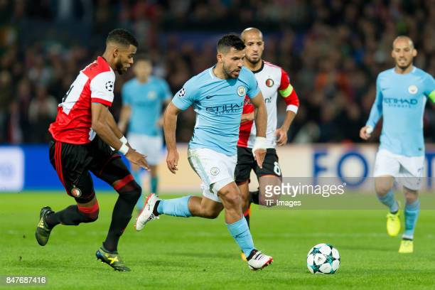 Eric Botteghin of Rotterdam and Sergio Agueero of Manchester City battle for the ball during the UEFA Champions League match between Feyenoord...