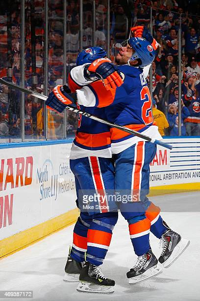 Eric Boulton of the New York Islanders is congratulated by teammate Tyler Kennedy after scoring a third period goal against the Columbus Blue Jackets...