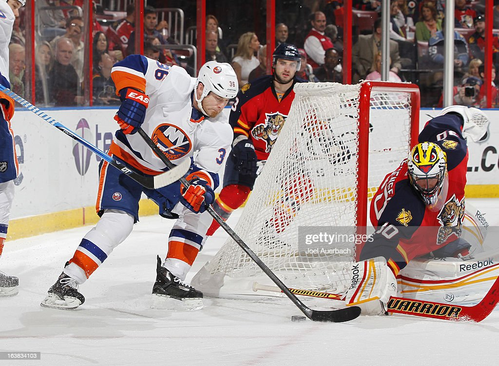 Eric Boulton #36 of the New York Islanders is unable to get the puck past Goaltender Scott Clemmensen #30 of the Florida Panthers at the BB&T Center on March 16, 2013 in Sunrise, Florida.