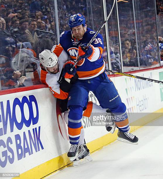 Eric Boulton of the New York Islanders steps into Radko Gudas of the Philadelphia Flyers during the first period at the Barclays Center on April 10...