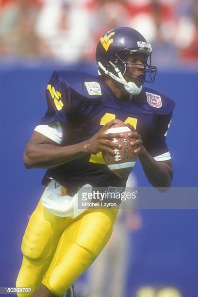 Eric Boykin of the West Virginia Mountaineers looks to throw a pass during a college football game against the Nebraska Cornhuskers on August 31,...