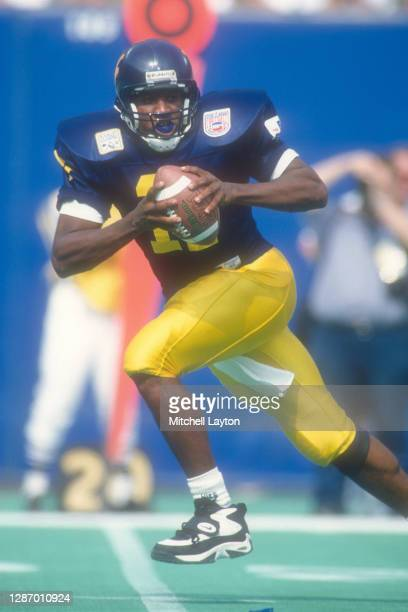 Eric Boyton of the West Virginia Mountaineers looks to throw a pass during a college football game against the Nebraska Cornhuskers on August 31,...