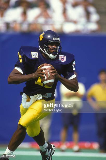 Eric Boyton of the West Virginia Mountaineers looks to throw a pass during a college football game against the Nebraska Cornhuskers on August 31 1994...