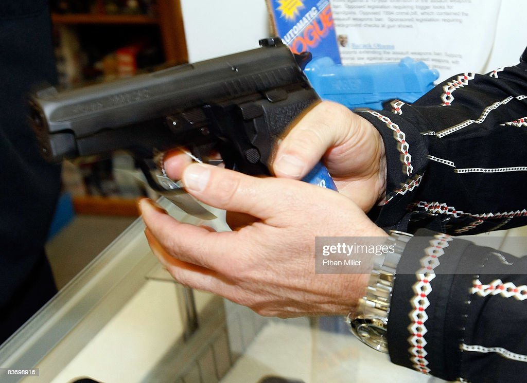 Eric Brandon of Nevada tries out a semi-automatic pistol at The Gun Store November 14, 2008 in Las Vegas, Nevada. Store manager Cliff Wilson said he's seen a large spike in sales since Barack Obama was elected president on November 4, with customers citing fears about the president-elect's record on firearms. The election, combined with a slumping economy, has contributed to an overall increase of 25-30 percent in gun sales at the store, Wilson said.