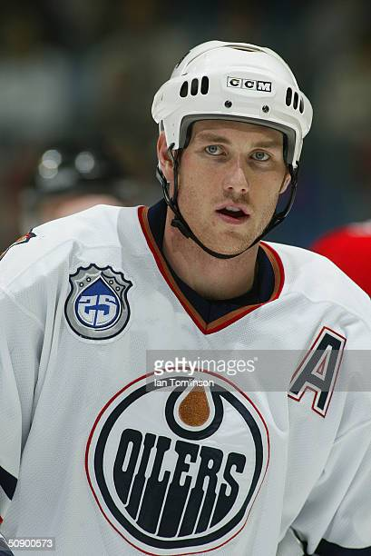 Eric Brewer of the Edmonton Oilers looks on during the game against the Calgary Flames at The Pengrowth Saddledome on December 23 2003 in Calgary...