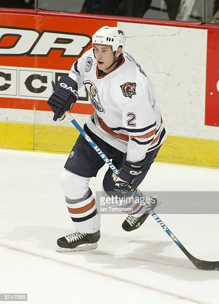 Eric Brewer of the Edmonton Oilers skates against the Calgary Flames on March 9 2004 at The Pengrowth Saddledome in Calgary Alberta The Oilers and...