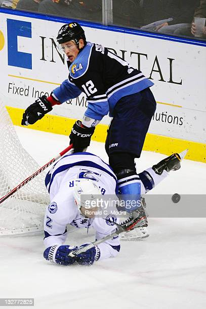 Eric Brewer of the Tampa Bay Lightning tangles wit Jack Skille of the Florida Panthers during a NHL game on November 6 2011 at the BankAtlantic...