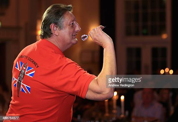 Eric Bristow fivetime world darts champion is pictured during the Pound 4 Pound Charity fundraiser for Fight4change on May 7 2014 in London England