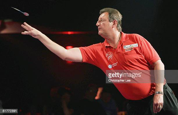 Eric Bristow in action during the Showdown match between Eric Bristow and John Lowe at The Circus Tavern on November 21 2004 in Purfleet England
