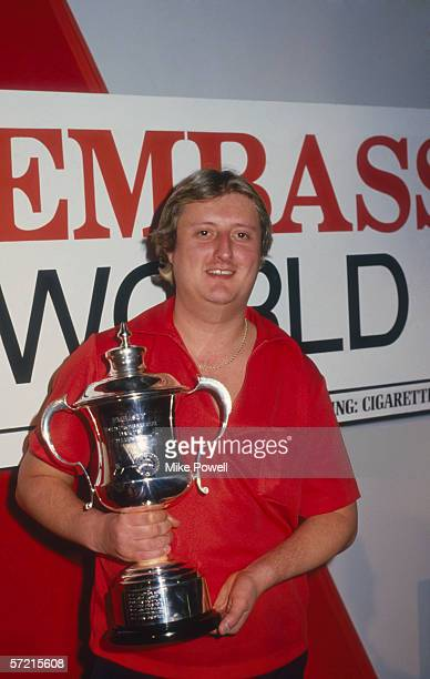 Eric Bristow lifts the trophy after winning the World Darts Championships held in 1985 at the Jollees Nightclub in Stoke England