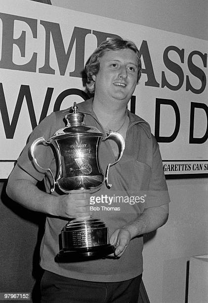 Eric Bristow of England holds the trophy after winning the Embassy World Professional Darts Championship held at StokeonTrent England on the 12th...