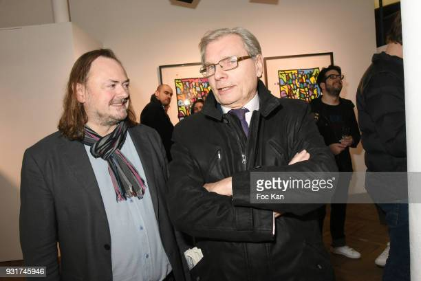 Eric Brugier and art critic Jean Luc Chalumeau attend ÔÔBirth of The WindÕ JonOne PreviewÊÈ at Galerie Brugier Rigail on March 13 2018 in Paris France