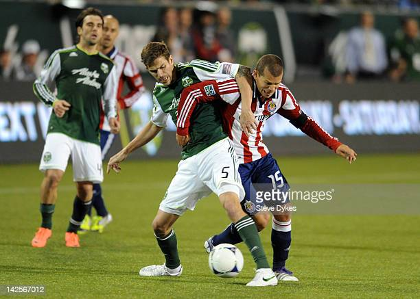 Eric Brunner of the Portland Timbers battles for the ball with Alejandro Moreno of the Chivas USA during the second half of the game at JeldWen Field...