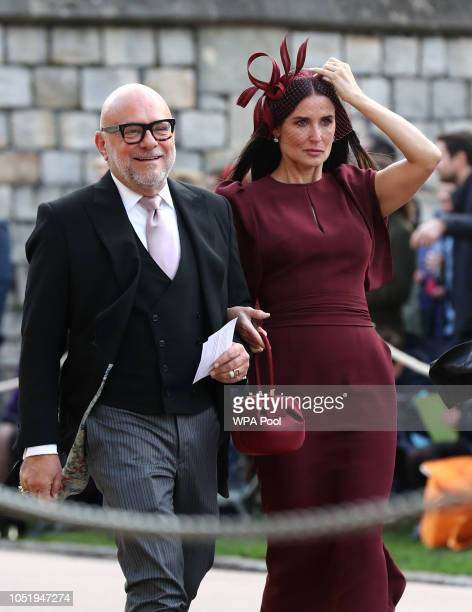 Eric Buterbaugh and Demi Moore arrive ahead of the wedding of Princess Eugenie of York to Jack Brooksbank at Windsor Castle on October 12 2018 in...