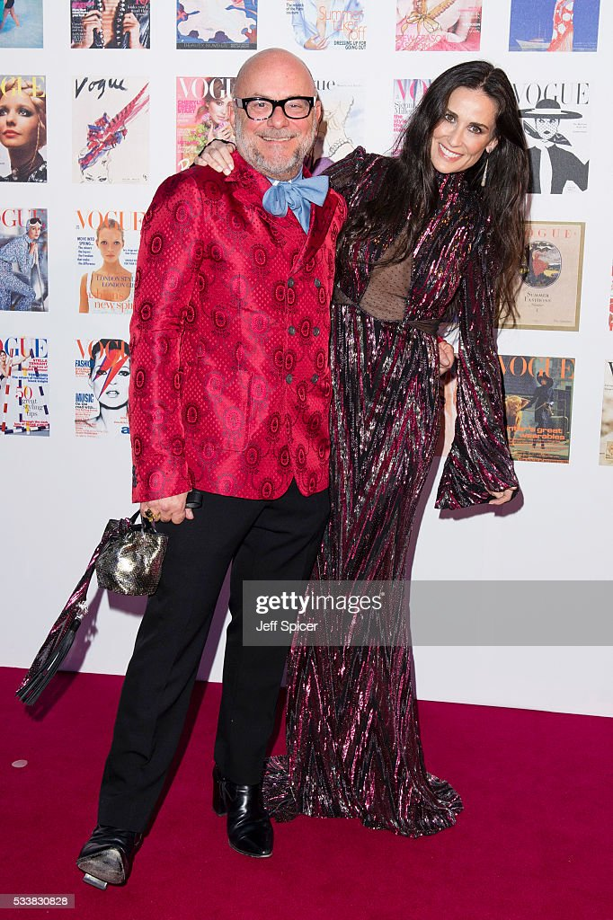 Eric Buterbaugh and Demi Moore arrive for the Gala to celebrate the Vogue 100 Festival at Kensington Gardens on May 23, 2016 in London, England.