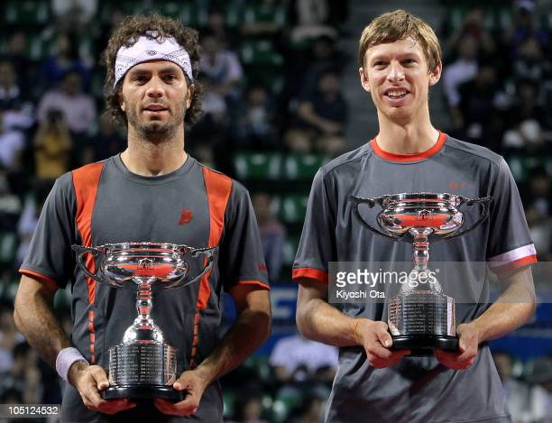 Eric Butorac of the United States and JeanJulien Roger of the Netherlands Antilles pose with trophies during the award ceremony after winning the...